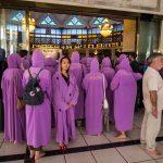 Tourists in purple djellaba in the National Mosque, Kuala Lumpur