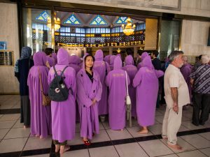 Tourists in purple djellaba in the National Mosque, Kuala Lumpur