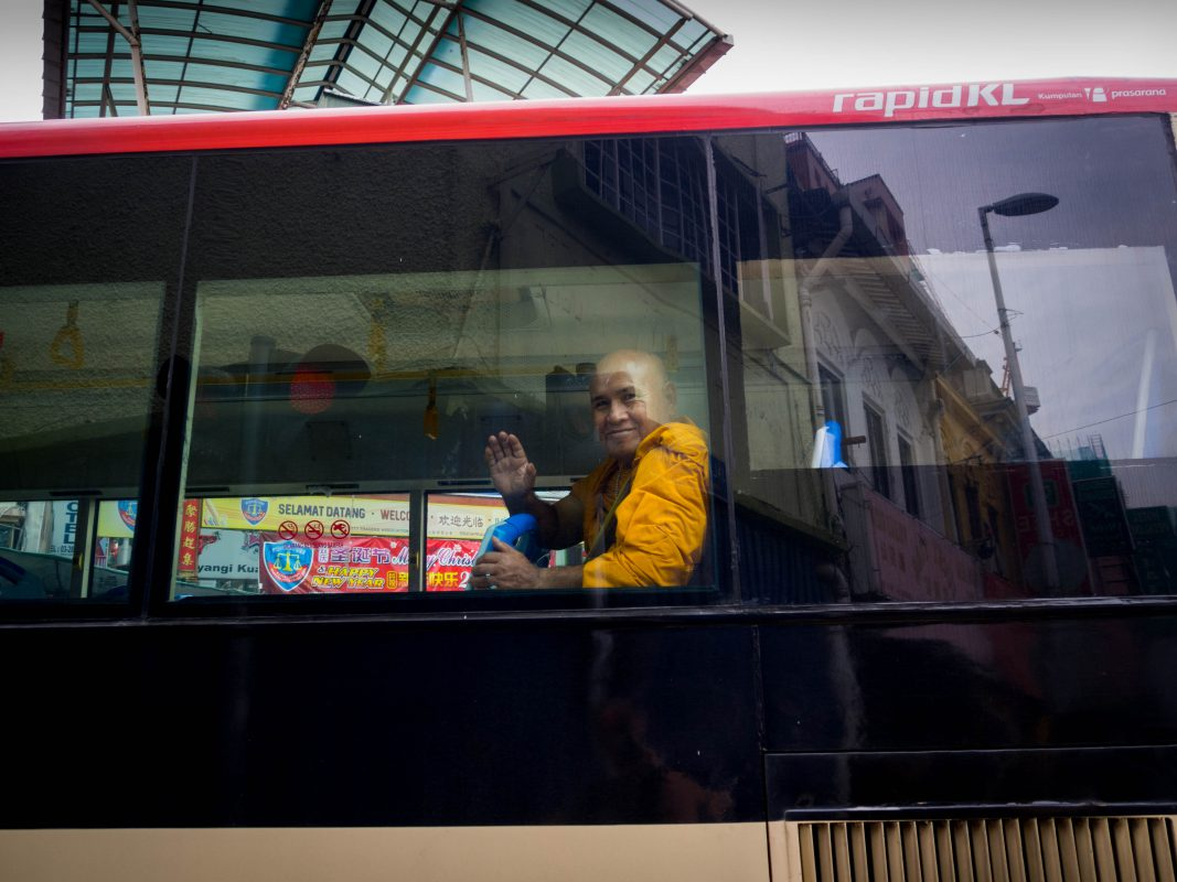 Buddhist monk waving at me near Petaling Street, Kuala Lumpur