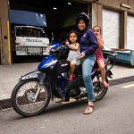 Mother with small children on motorbike, Kuala Lumpur, Malaysia